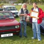 "Tim receiving ""Coupe of the run"" from show organiser John Greene"