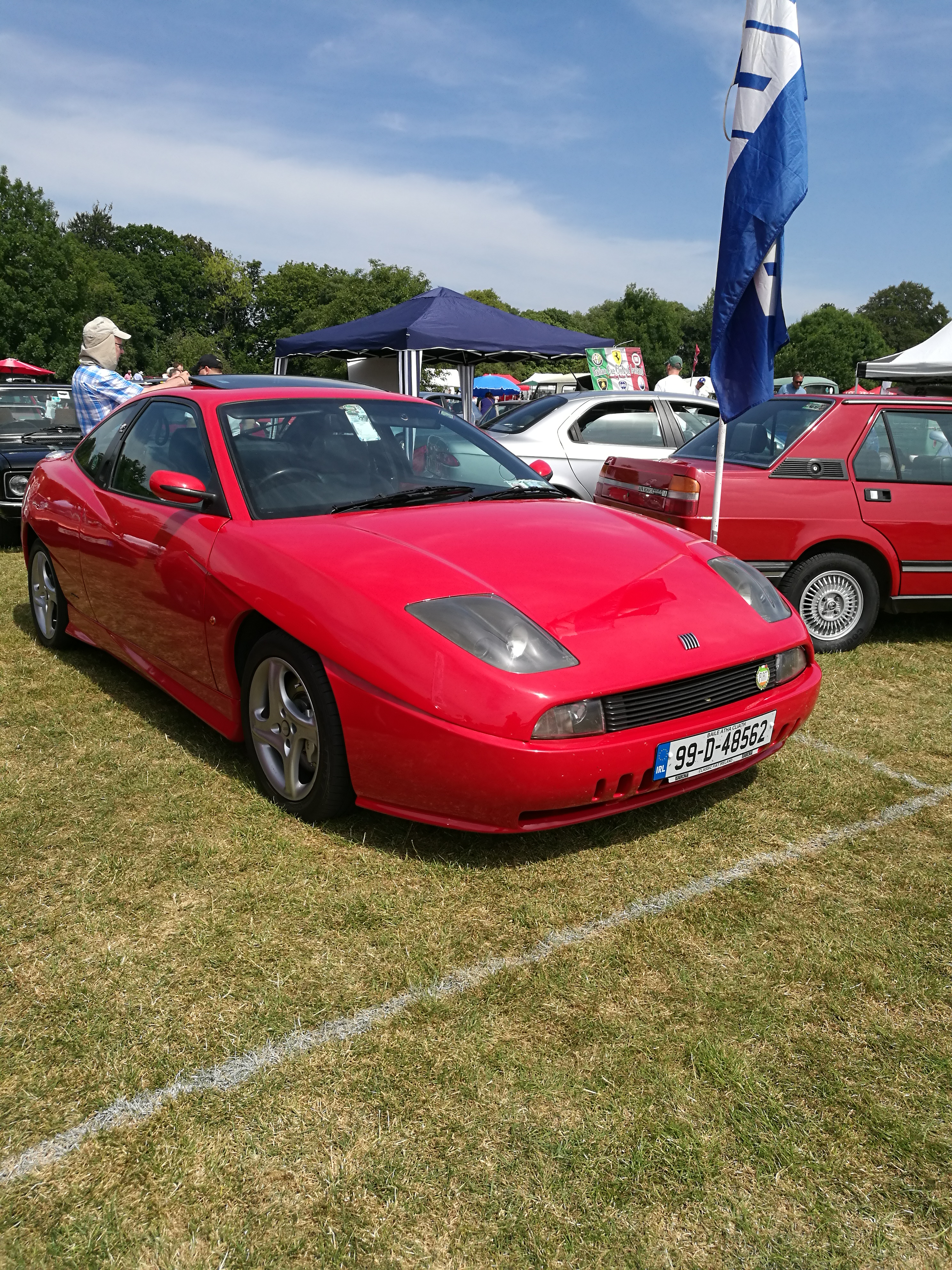 The other lady in red the Fiat Coupe